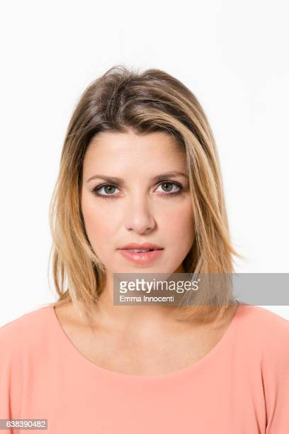 Blonde woman staring at camera