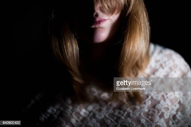 blonde woman wearing lace top - unrecognisable person stock pictures, royalty-free photos & images
