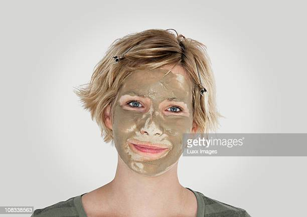 Blonde woman with clay face mask
