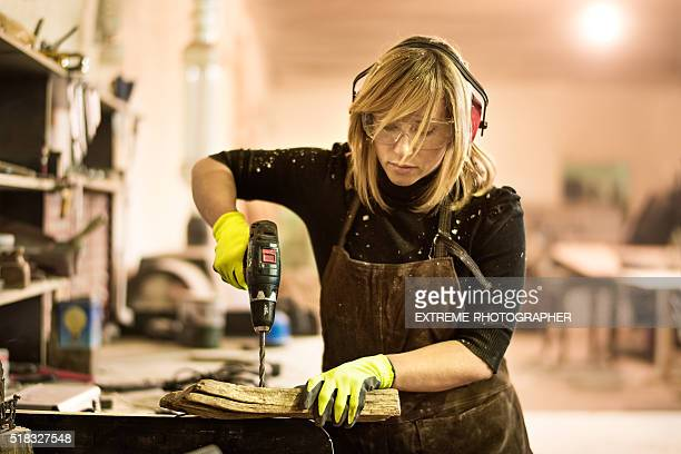 Blonde woman with electric drill