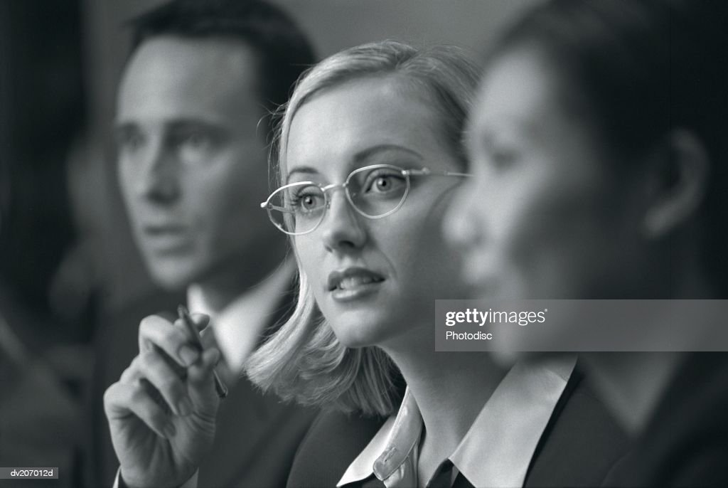 Blonde woman with glasses in meeting : Stock Photo