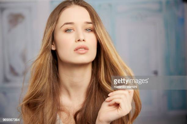 blonde woman with long hair and natural look posing for a portrait