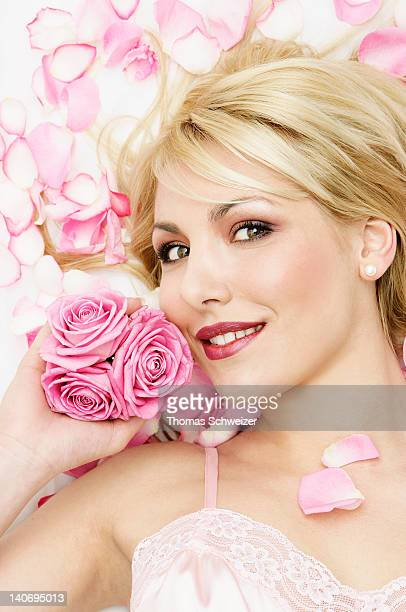 Blonde woman with pink roses
