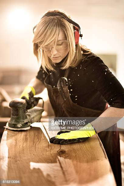 Blonde woman with power sander