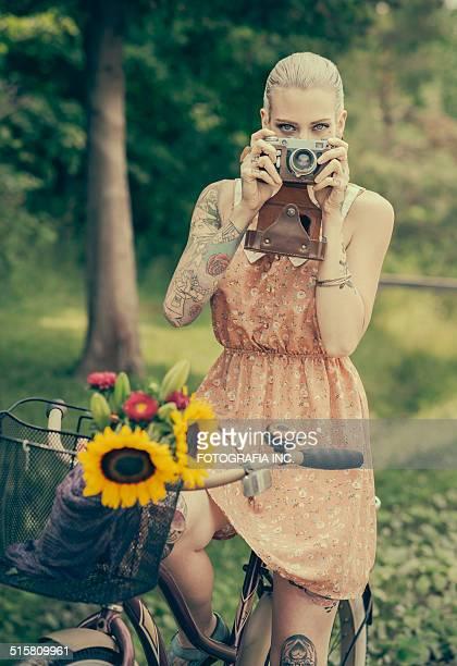 Blonde woman with the vintage rangefinder