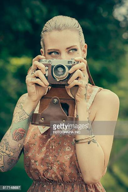 Blonde woman with the vintage rangefinder