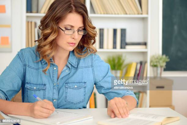 blonde woman working in the office - filing documents stock pictures, royalty-free photos & images