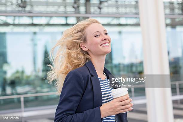 blonde women running with coffee
