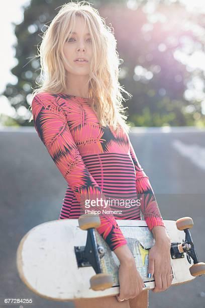 blonde women with skateboard