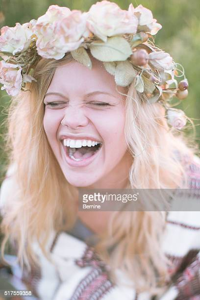 Blonde Young Adult Female Laughing with Flower Crown