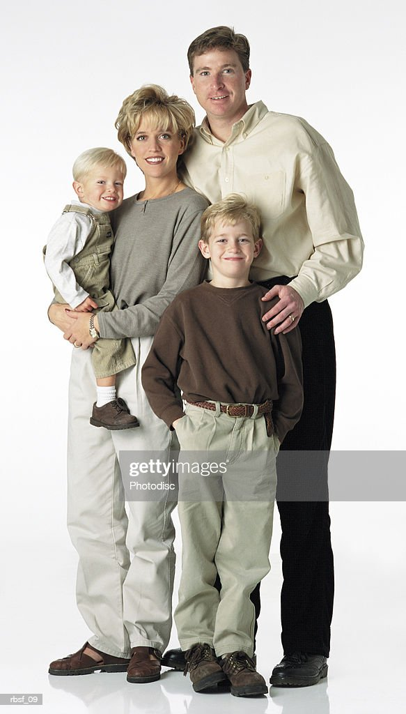 blonde yuppie family of four in khaki clothing stand together : Foto de stock