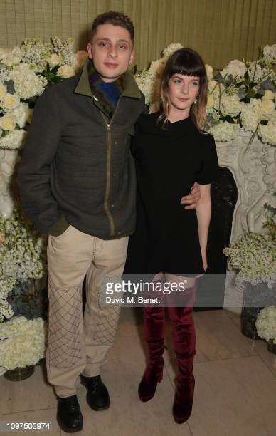 Blondey McCoy and guest attend the British Vogue and Tiffany Co Celebrate Fashion and Film Party at Annabel's on February 10 2019 in London England