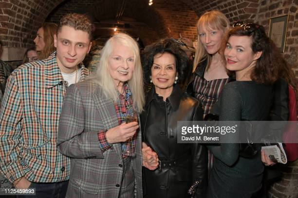 Blondey McCoy Dame Vivienne Westwood Bianca Jagger Jade Parfitt and Jasmine Guinness pose backstage at the Vivienne Westwood show during London...