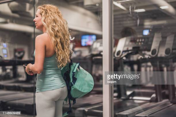 blondie female whit training bag in the gym. - log on stock photos and pictures