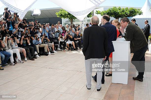 Blondin Miguel JeanPierre Darroussin Aki Kaurismaki and Kati Outinen at the photo call of 'Le Havre' during the 64th Cannes International Film...