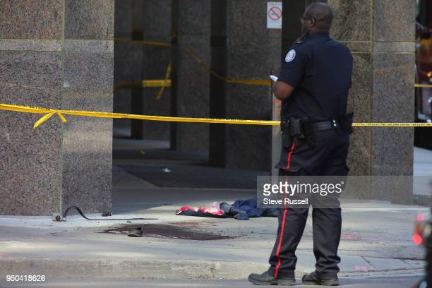 TORONTO ON APRIL 23 Blood and clothing are on the Westside sidewalk at Park Home Avenue as the Police investigate a van that ran down pedestrians...