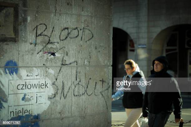Blood and honour, the name of a neo Nazi music promotion network and political group is seen written on a wall in the center of the city on October...