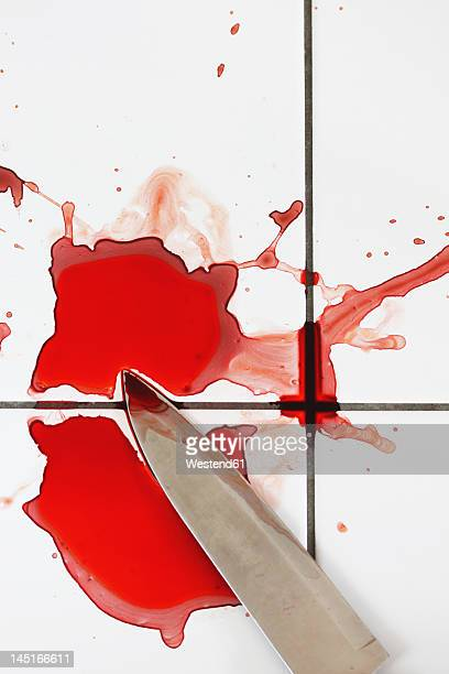 Blood and knife on tiled floor