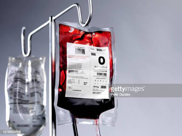 blood bag and saline drip on hospital stand - saline stock pictures, royalty-free photos & images