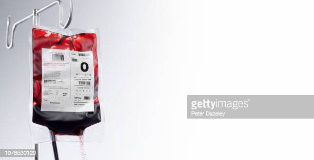 blood bag on hospital stand with copy space - blood donation stock pictures, royalty-free photos & images