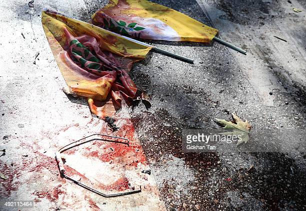 Blood covered flags are seen at the blast scene after an explosion during a peace march in Ankara October 10 2015 Turkey At least 30 people were...
