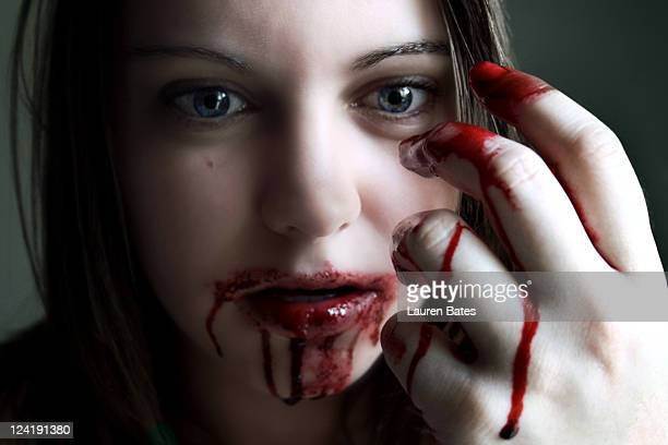 Blood covered hand and mouth