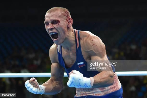 Blood covered Russia's Vladimir Nikitin reacts to winning against Ireland's Michael John Conlan during the Men's Bantam Quarterfinal 1 match at the...