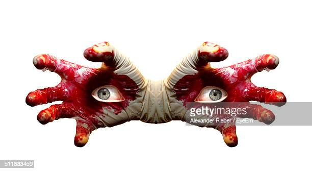 blood hand with human eye - evil stock pictures, royalty-free photos & images