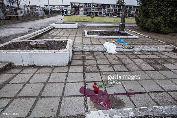 Blood in the location where Yuri Dement the closest partner of the mayor of Kharkiv Gennady Kernes was shot dead near his mother's grave in Kharkiv...