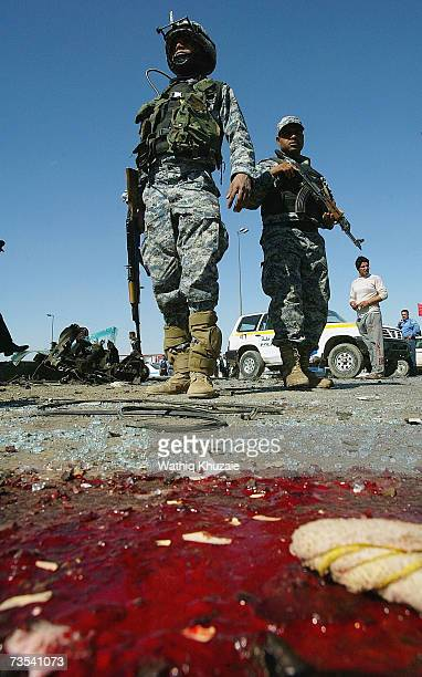 Blood is seen as Iraqi soldiers secure the scene of a car bomb explosion on March 10 2007 near Sadr city Shiite neighborhood in Baghdad Iraq As...