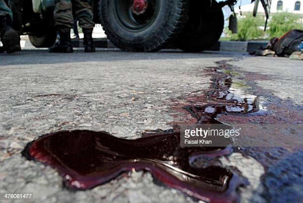 CONTENT] Blood is seen near shootout scene in Hyderpora SrinagarKashmir where militants kill five Indian army men and injure several others