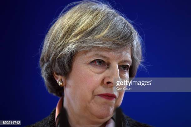 A blood mark is seen on the eye of British Prime Minister Theresa May as she speaks during a press conference at the Council of the European Union on...