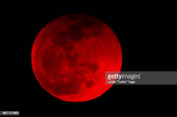 blood moon 2014 - total lunar eclipse stock photos and pictures