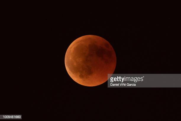 blood moon, full lunar eclipse, spain, july 2018 - supermoon stock pictures, royalty-free photos & images