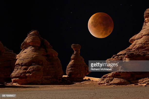 Blood moon over Libyan desert