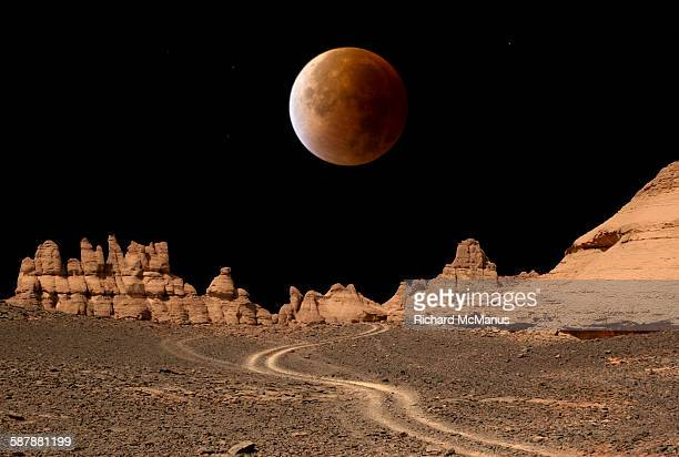 Blood moon over Libyan desert.