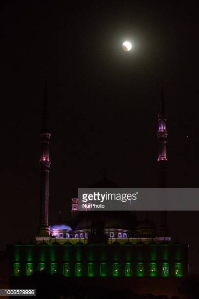 A blood moon over Mohamed Ali Mosquein Cairo on July 27 2018 The blood moon lunar eclipse on July 27 is expected to be the longest in the 21st...