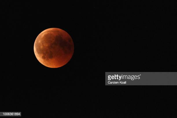 Blood Moon rises in the sky on July 27 2018 in Berlin Germany The period of totality during this eclipse when Earth's shadow is directly across the...