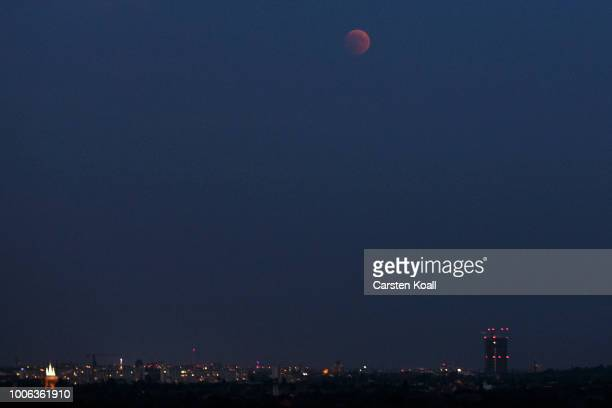 Blood Moon rises over the skyline on July 27 2018 in Berlin Germany The period of totality during this eclipse when Earth's shadow is directly across...