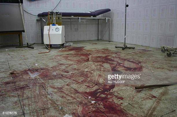 Blood of Iraqi victims covers the floor of an emergency room at a hospital in Baquba following a suicide car bomb attack that targeted tents set up...