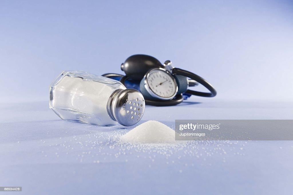 Blood pressure cuff and salt : Stock Photo