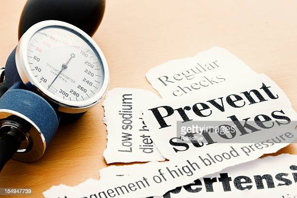 blood pressure gauge with headlines on stroke prevention and hypertension - sodium stock photos and pictures