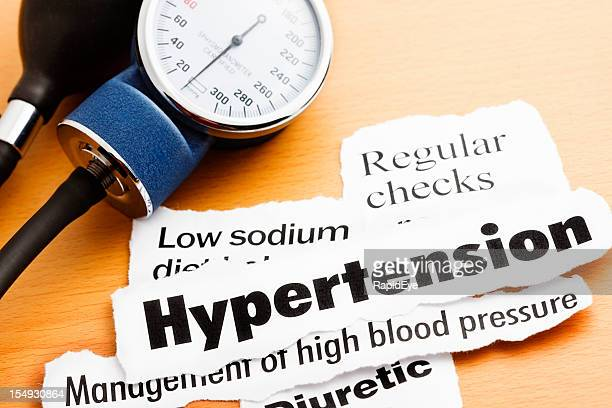 Blood pressure meter with headlines about hypertension