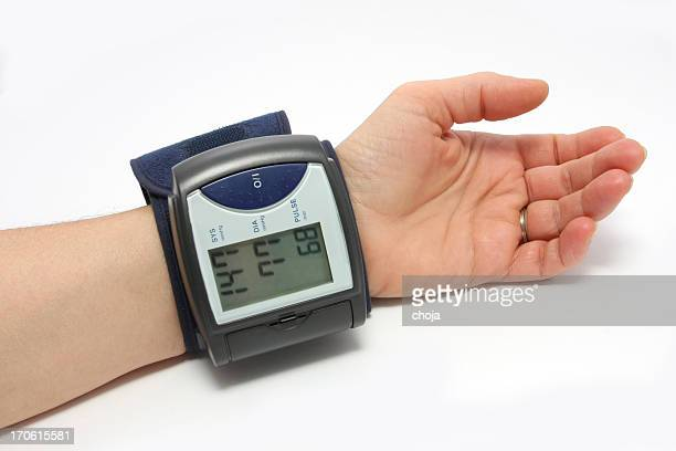 blood pressure monitor on a wrist - human artery stock photos and pictures