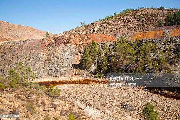 Blood red mineral laden water in the Rio Tinto river in the Minas de Riotinto mining area Huelva province Spain