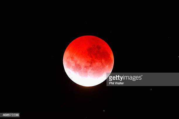 A blood red moon lights up the sky during a total lunar eclipse on April 4 2015 in Auckland New Zealand The shortest total lunar eclipse or 'blood...