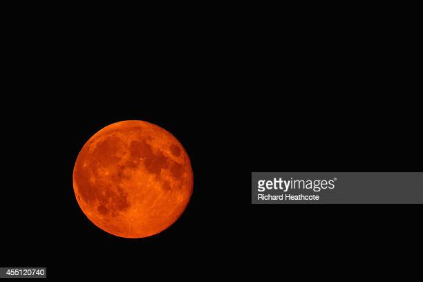 A blood red Supermoon is seen rising in the sky on September 9 2014 in High Wycombe England
