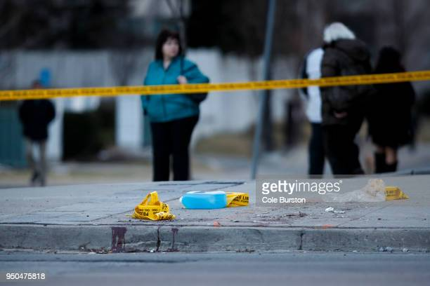 Blood remains at the scene on Yonge St at Finch Ave after a van plowed into pedestrians on April 23 2018 in Toronto Canada A suspect identified as...