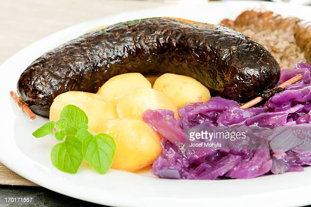 Blood sausage, white pudding, red cabbage and potatoes