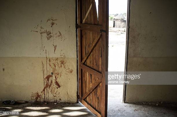 Blood smeared on the walls of a mosque, the wooden door staved in, after an attack in Kilelengwani village, in Kenya's troubled Tana Delta, which...